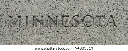 "The word ""Minnesota"" carved into granite"