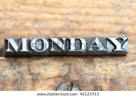 """the word """"monday"""" in letterpress type on a wooden background. - stock photo"""