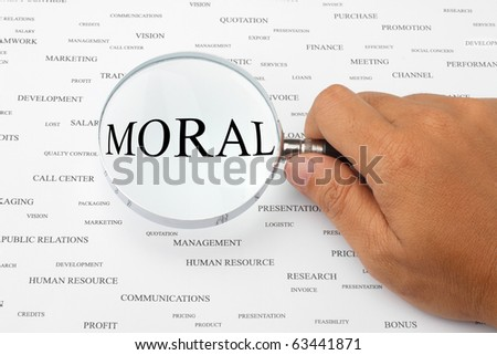 The word MORAL is magnified. - stock photo