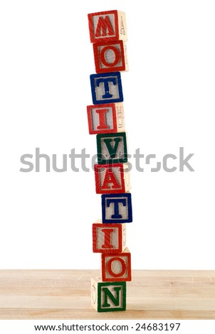 The word motivation spelled using colored baby blocks - stock photo