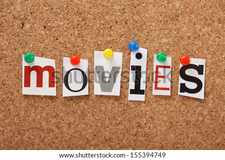 The word Movies in cut out magazine letters pinned to a cork notice board