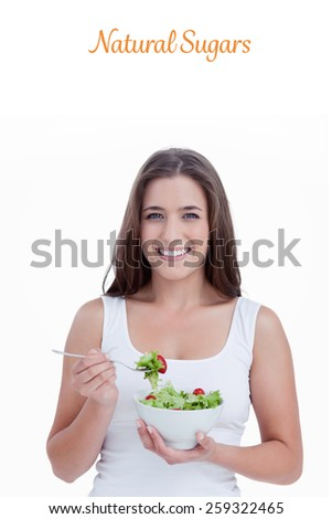 The word natural sugars against smiling woman eating a salad