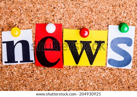 The word news in cut out magazine letters pinned to a cork notice board. - stock photo