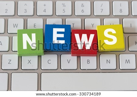 The Word NEWS on Colorful Wooden Cubes - stock photo