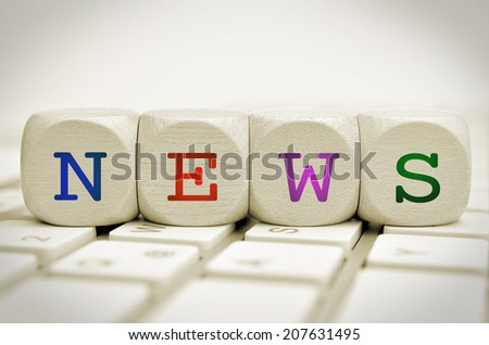 the word news on cubes on a keyboard - stock photo
