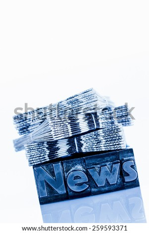 the word news written with lead letters. photo icon for newsletters, newspapers and information - stock photo