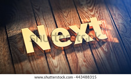 """The word """"Next"""" is lined with gold letters on wooden planks. 3D illustration image - stock photo"""