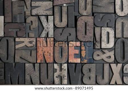 The word Noel written in very old letterpress type - stock photo