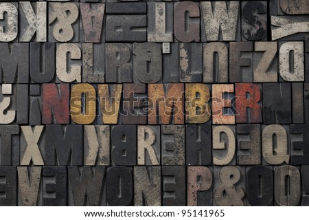 The word November written in antique letterpress printing blocks. - stock photo