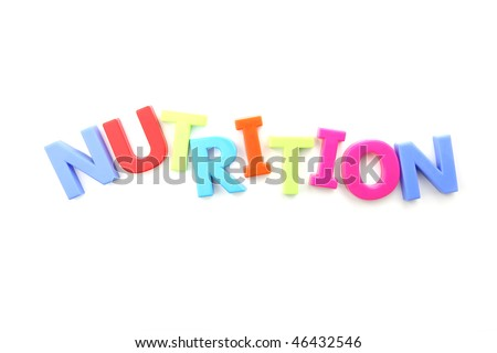 The word nutrition spelled out using colored fridge magnets, isolated on white