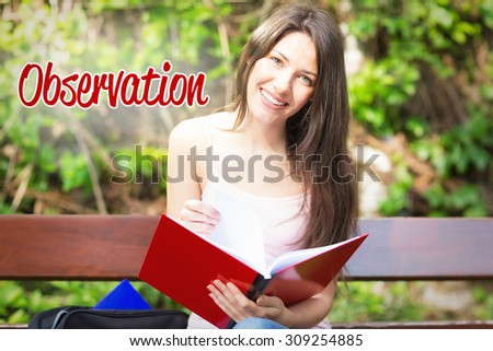 The word observation against pretty student studying outside on campus - stock photo