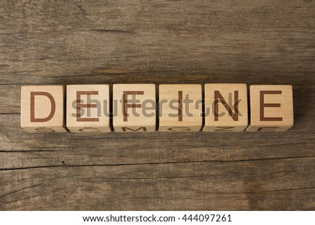 the word of DEFINE on wooden cubes
