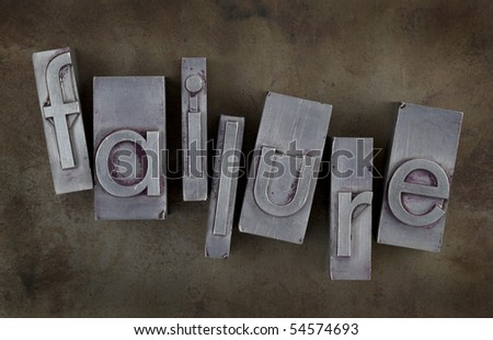 the word of failure in old metal letterpress type blocks on rusty and grunge background