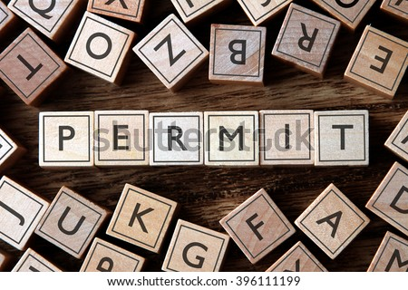 the word of PERMIT on building blocks concept - stock photo