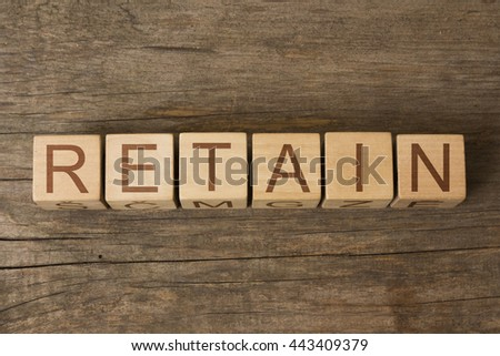 the word of RETAIN on a wooden cubes