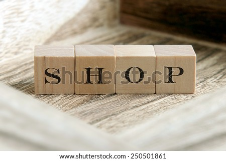 the word of SHOP on wooden cubes