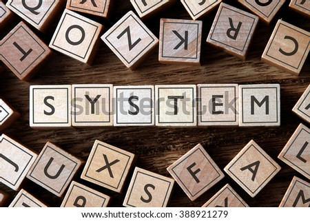 the word of SYSTEM on building blocks concept - stock photo