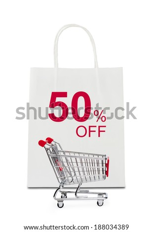 The word 50% off on shopping bag with shopping cart - stock photo