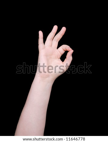 the word ok or okay in sign language on a black background - stock photo