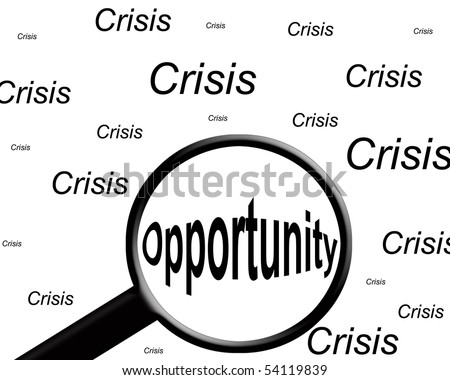 """the word """"opportunity"""" highlighted with a magnifying glass in a field of """"crisis"""" words. - stock photo"""