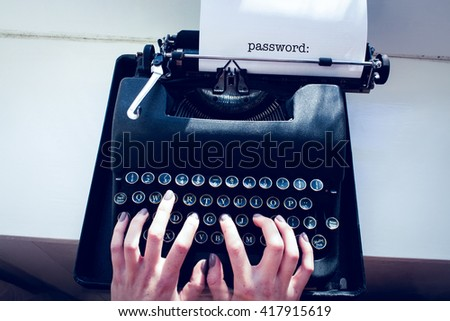 The word password: against womans hand typing on typewriter - stock photo