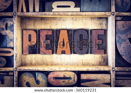 "The word ""Peace"" written in vintage wooden letterpress type."