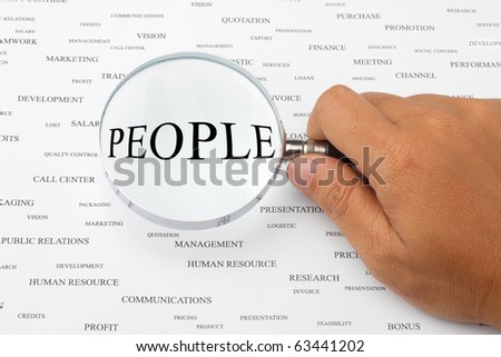 The word PEOPLE is magnified. - stock photo