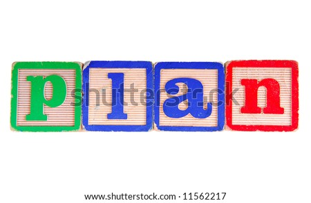 The word PLAN spelled out using antique wooden letter blocks - stock photo