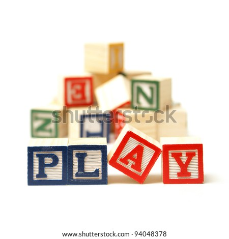 The word play has been spelled out while playing with toy blocks. - stock photo