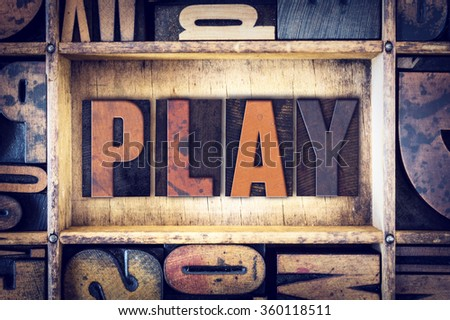 "The word ""Play"" written in vintage wooden letterpress type. - stock photo"