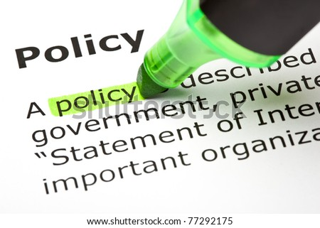 The word Policy highlighted with green marker. - stock photo