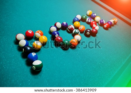 The word pool from billiard balls - stock photo