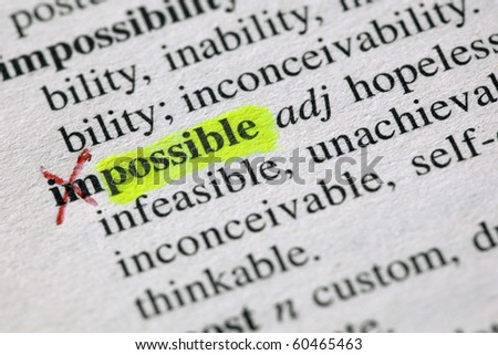 The word possible highligted from impossible in a dictionary - stock photo