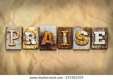 "The word ""PRAISE"" written in rusty metal letterpress type on a crumbled aged paper background. - stock photo"