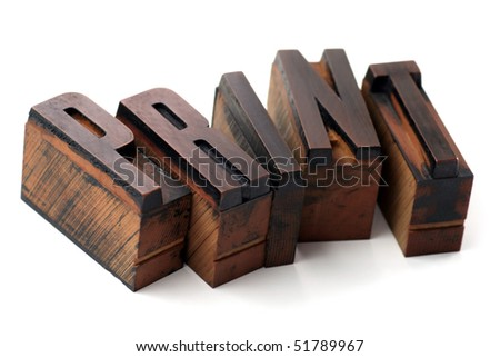 The word Print in old wooden inked letterpress type - stock photo