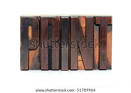 The word Print in old wooden letterpress type - isolated on white background - stock photo