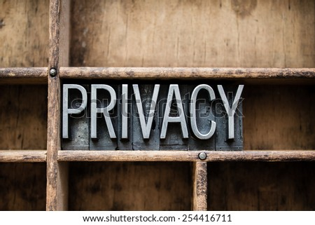"The word ""PRIVACY"" written in vintage metal letterpress type in a wooden drawer with dividers. - stock photo"