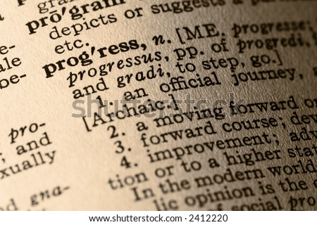 The word progress. Close-up of the word progress and its definition in a dictionary - stock photo