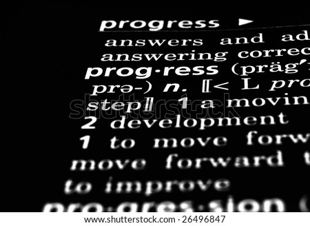 The word Progress in a dictionary, white on black