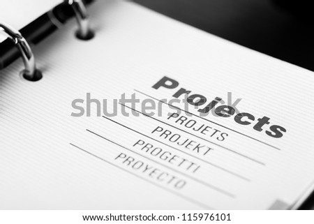 The word projects in different languages closeup in organizer - stock photo