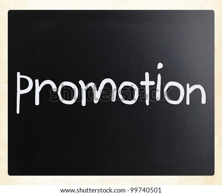 """The word """"promotion"""" handwritten with white chalk on a blackboard - stock photo"""