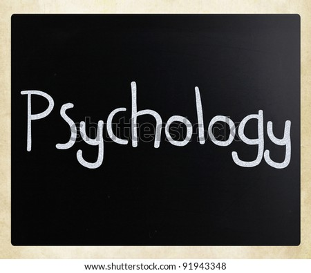 The word 'Psychology' handwritten with white chalk on a blackboard