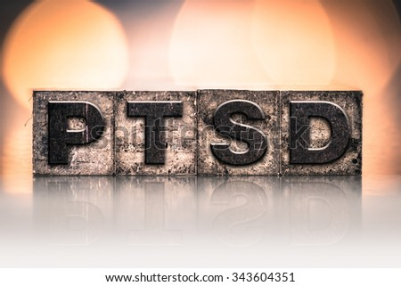 "The word ""PTSD"" written in vintage ink stained letterpress type. - stock photo"