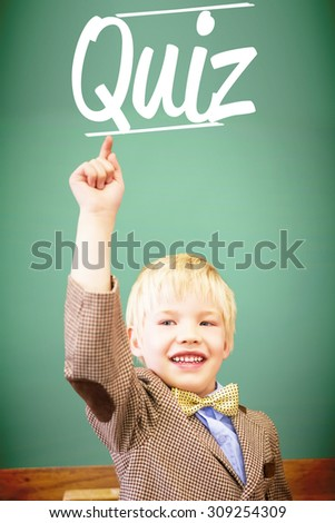 The word quiz against cute pupil dressed up as teacher in classroom - stock photo
