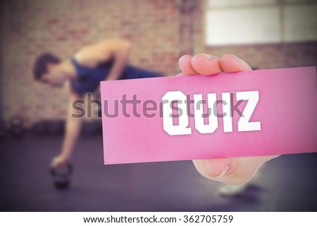 The word quiz and young woman holding blank card against - stock photo