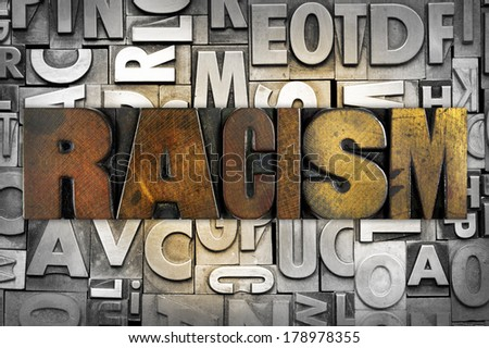 The word RACISM written in vintage letterpress type