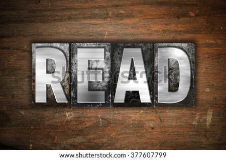 "The word ""Read"" written in vintage metal letterpress type on an aged wooden background. - stock photo"