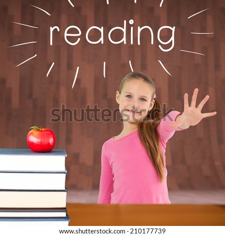The word reading and cute girl with hand out against red apple on pile of books - stock photo
