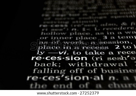 The word Recession in a dictionary white on black - stock photo