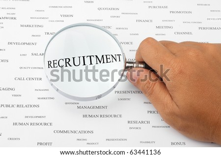 The word RECRUITMENT is magnified. - stock photo